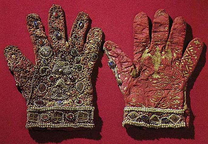 Gloves were probably made in Sicily for Roger II for his coronation in 1220. They are from red silk, decorated by gold, pearls and sapphire. Kunsthistorische museum, Vienna