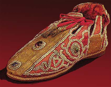 Shoes of German emperors made in Sicily at beginning of 13th century. Decorated by red silk, golden hems, jewelry and pearls. Kunsthistorische museum, Vienna